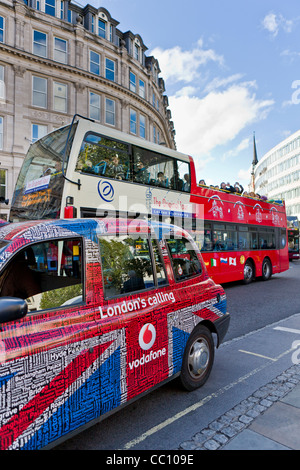 London Taxi cab with the Union Jack Design covered in Street Names, UK - Stock Photo