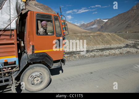 Turbaned truck driver in his cab on the Leh-Manali Highway, Himachal Pradesh, India - Stock Photo
