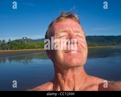 A middle aged man taking the sun in Costa Rica - Stock Photo
