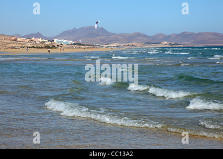 Kitesurfing on the beach on Canary Island Fuerteventura, Spain - Stock Photo