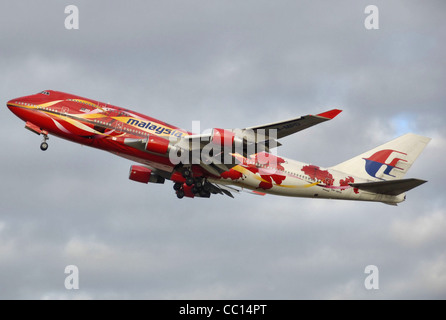 Malaysia Airlines Boeing 747-400 (9M-MPD) taking off from London Heathrow Airport, England. - Stock Photo