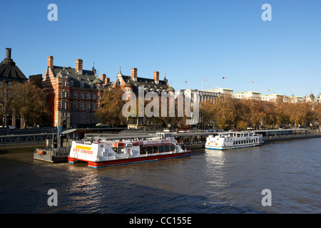 London river cruise boats at the westminster millennium pier on the river thames England UK United kingdom - Stock Photo
