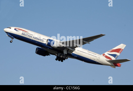 British Airways Boeing 777-200 (G-YMMD) takes off from London Heathrow Airport, England - Stock Photo