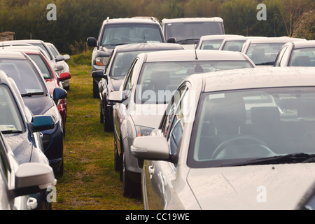 Parked cars waiting to be sold, Dunmaway, County Cork, Republic of Ireland. - Stock Photo