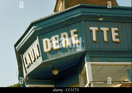 Close up of the sign over the launderette. - Stock Photo