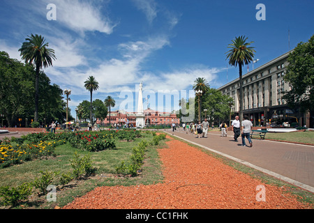 Casa Rosada and the Pirámide de Mayo / May Pyramid on the Plaza de Mayo in Buenos Aires, Argentina - Stock Photo