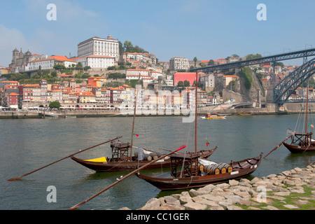 Rabelo boats anchored at Vila Nova de Gaia in front of Ribeira district, Porto, Portugal, Unesco World Heritage - Stock Photo