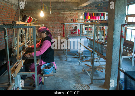 Weavers at a cooperative in Old Manali, Himachal Pradesh, India - Stock Photo