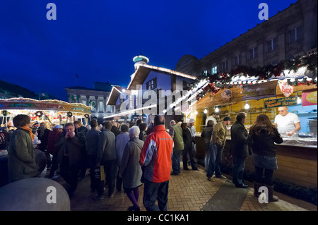 Food stalls in front of the Council House at the Frankfurt German Christmas Market, Victoria Square, Birmingham, - Stock Photo