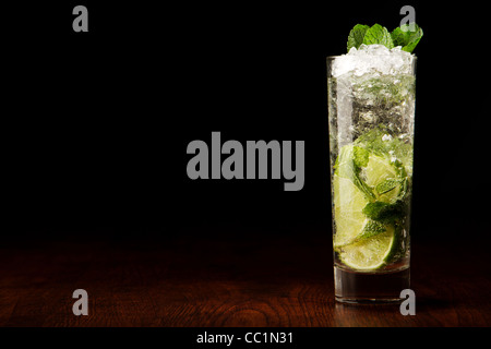 Mojito Cocktail on a wooden table and black - Stock Photo