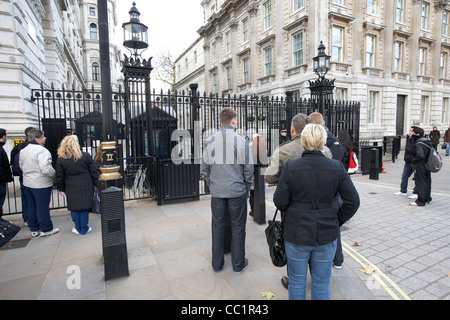 tourists outside the closed security gates of downing street at whitehall London England UK United kingdom - Stock Photo