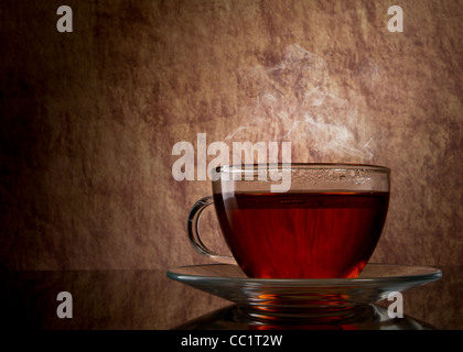 tea in glass cup on old stone background - Stock Photo