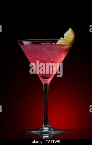 Cosmopolitan cocktail drink on a red gradient - Stock Photo