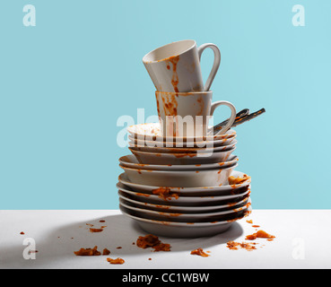 Studio shot of dirty, white dishes stacked - Stock Photo