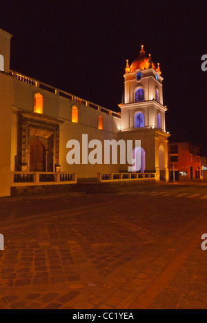 Night photograph of the bell tower of the cathedral on the main plaza in Latacunga, Ecuador. - Stock Photo