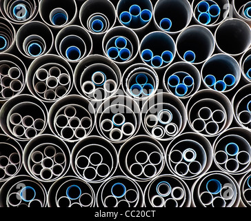 Plastic water pipes pattern in India. Circles within circles abstract - Stock Photo