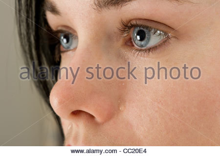 close up of a young woman crying - Stock Photo