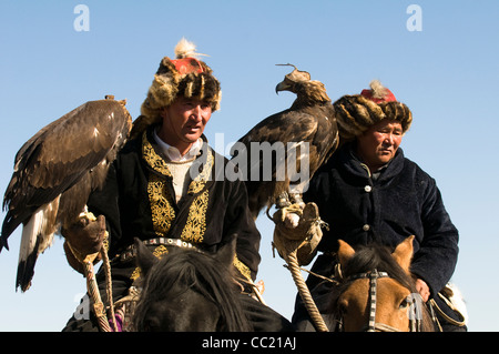 Kazakh eagle hunters gather in the annual eagle hunter festival in Bayan Olgii in western Mongolia. - Stock Photo