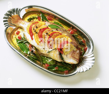 Baked Sea Bream with Citrus Fruits and Tomatoes - Stock Photo