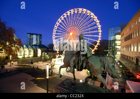 Christmas market, Ferris wheel in the city center of Essen, Germany, Europe. - Stock Photo
