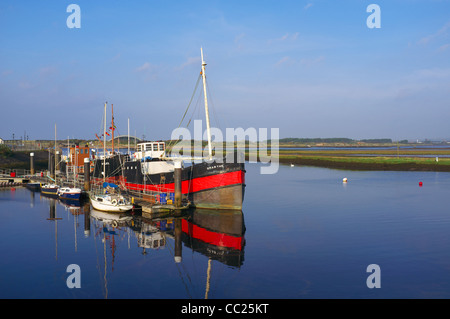 Irvine harbour with the 'Spartan' tug boat, berthed and decommissioned - Stock Photo