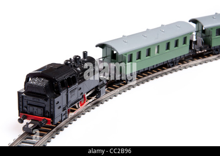 Toy steam train pushing two carriages isolated on white background - Stock Photo