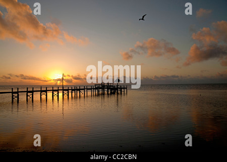 sunset at a pier in Marathon, Florida Keys, Florida, USA - Stock Photo