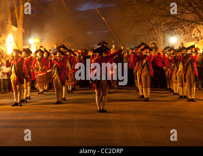 Soldiers marching in colonial uniform in the Grand Illumination at Williamsburg VA - Stock Photo