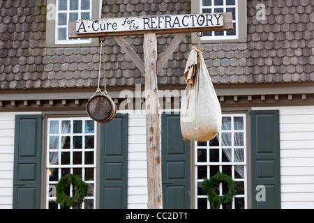 Old sign outside tavern in Colonial Williamsburg in Virginia - Stock Photo