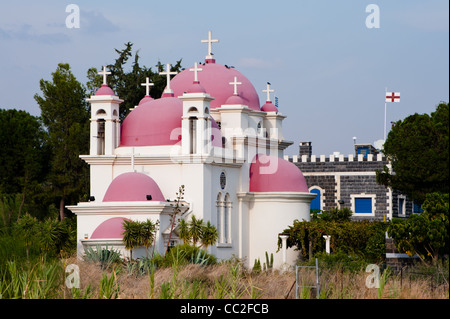 The pink domes of the Greek Orthodox Church of the Seven Apostles in Capernaum, Israel, on the shores of the Sea - Stock Photo