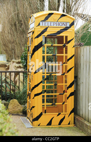 A wildlife themed traditional British Telecom BT red telephone box at Drusilla's Park Zoo, Alfriston, East Sussex, - Stock Photo