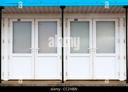 Beach huts at the seaside resort of Hunstanton in Norfolk closed up for the winter. - Stock Photo