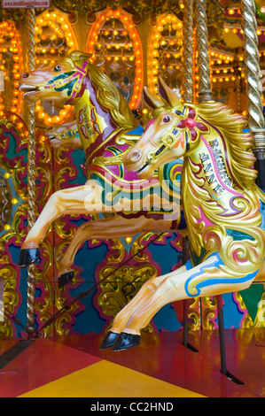 Horse rides on a traditional victorian carousel - Stock Photo