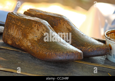 Old vintage wooden shoe form or mold for making shoes raised on a ...