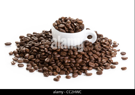 espresso coffee cup filled with and amongst roasted coffee beans isolated on a white background - Stock Photo