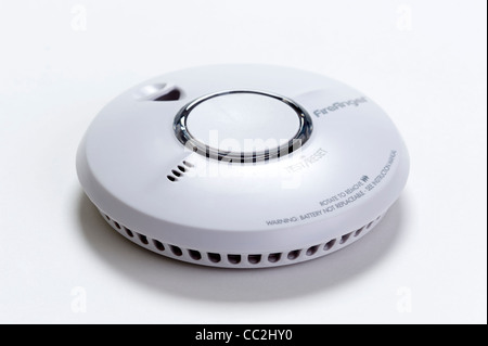 a domestic fire / smoke alarm or detector isolated on a white background - Stock Photo