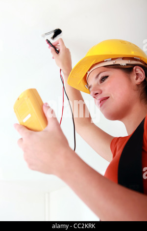 female electrician working - Stock Photo