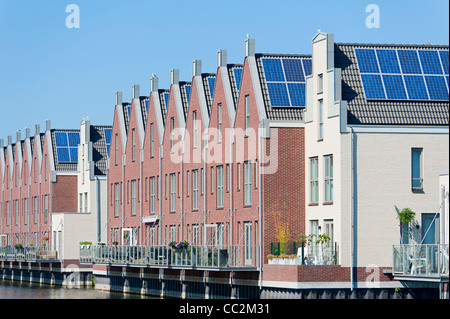 Modern Dutch houses with solar panels on roof - Stock Photo