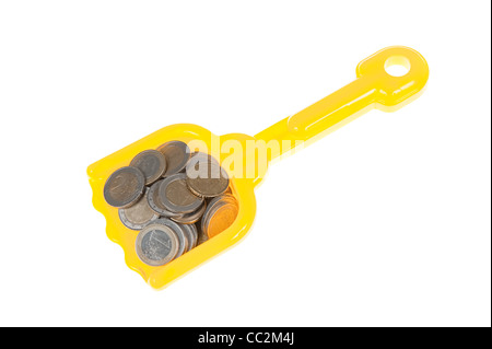 Toy shovel filled with euro coins - Stock Photo
