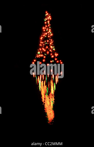 reflection of Christmas tree lights in water with black background - Stock Photo