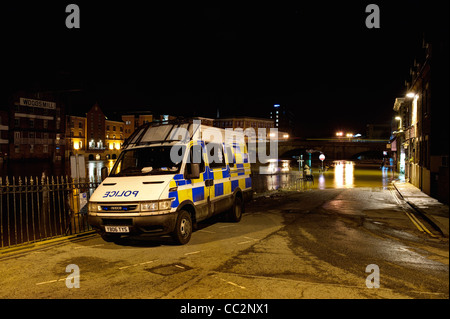 English British Police van parked in York city centre next to the flooded River Ouse - Stock Photo