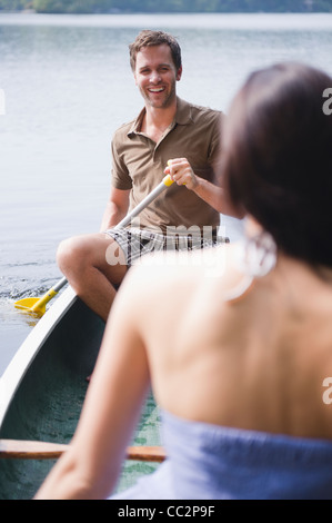 USA, New York, Putnam Valley, Roaring Brook Lake, Couple in boat on lake - Stock Photo