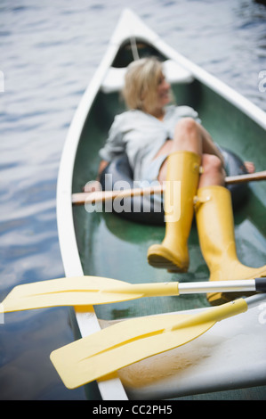 USA, New York, Putnam Valley, Roaring Brook Lake, Woman sitting in boat Stock Photo