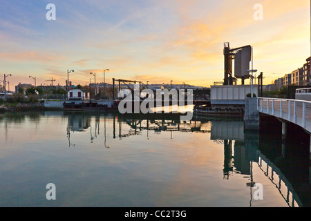 The historic 4th Street Bridge on the Mission Creek Channel in San Francisco at sunset. - Stock Photo