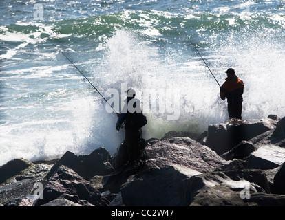 USA, New York, Long Island, Montaurk, Men fishing in sea - Stock Photo