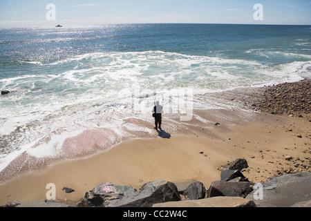 USA, New York, Long Island, Montaurk, Man fishing in sea - Stock Photo