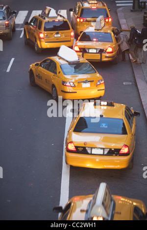 USA, New York City, Manhattan, Yellow cabs on 42nd street - Stock Photo