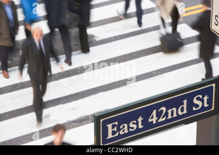 USA, New York City, Manhattan, 42nd street, Pedestrians on zebra crossing - Stock Photo