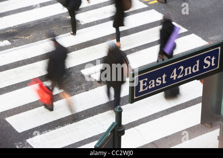 USA, New York City, Manhattan, 42nd street, Pedestrians on zebra crossing - Stock Photo