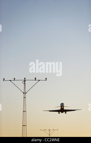 USA, New York City, Commercial aeroplane taking off from runway - Stock Photo